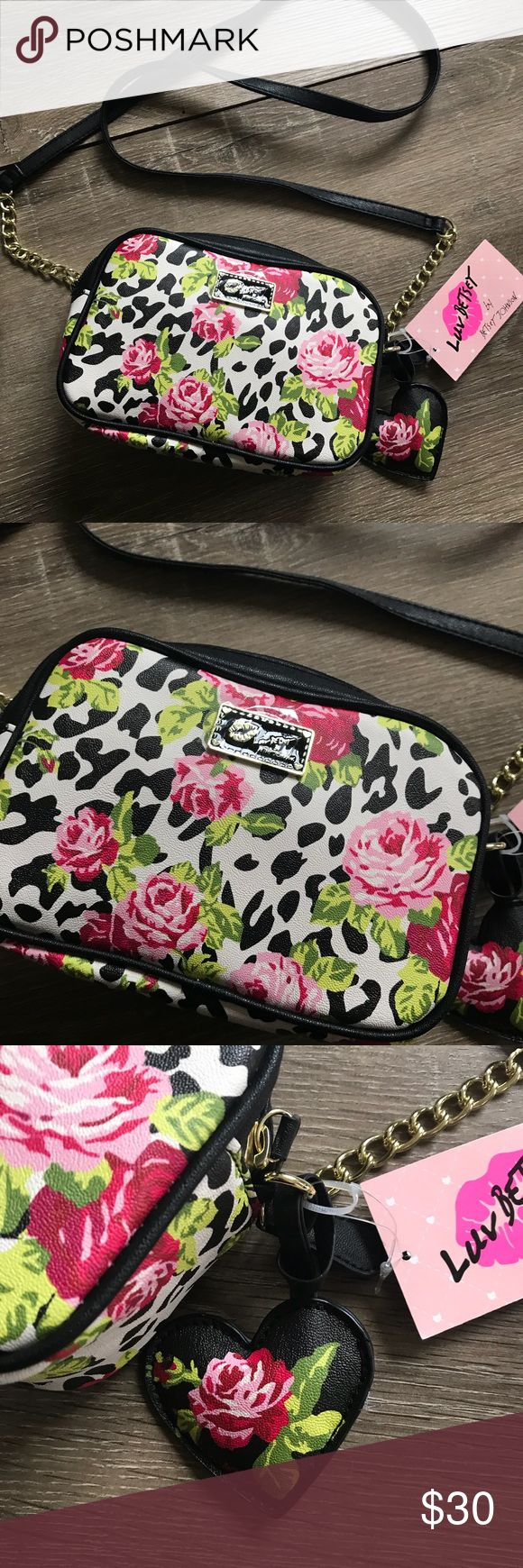 """Betsey Johnson • rose crossbody Betsey Johnson rose patterned crossbody on an animal print (leopard cheetah) background. Two zip compartments make for lots of storage. Removable heart decal.   Length7.5"""" Height 4.5"""" Depth 2.5"""" Shoulder drop 24"""" Betsey Johnson Bags Crossbody Bags"""