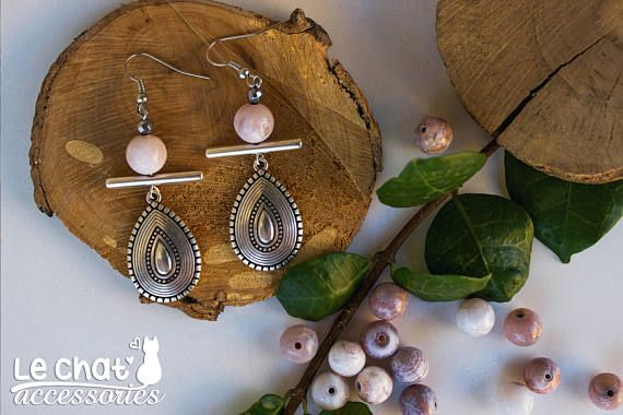 Check out this item in my Etsy shop https://www.etsy.com/listing/552374494/silver-ethic-drop-earrings