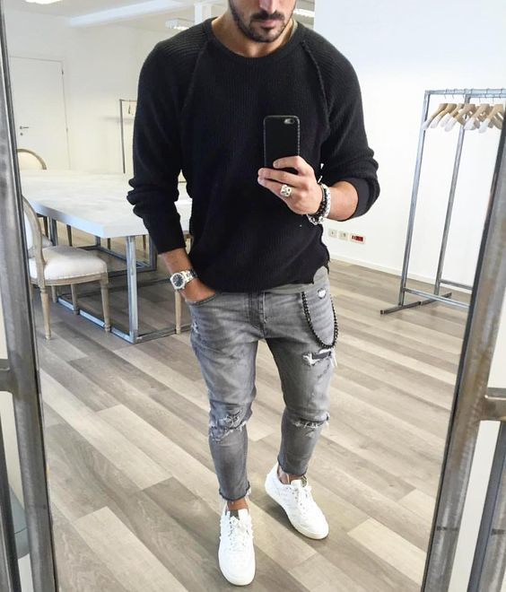 Shop this look on Lookastic: https://lookastic.com/men/looks/crew-neck-sweater-jeans-low-top-sneakers/19384   — Black Crew-neck Sweater  — Black Beaded Bracelet  — Silver Watch  — Grey Ripped Jeans  — White Low Top Sneakers