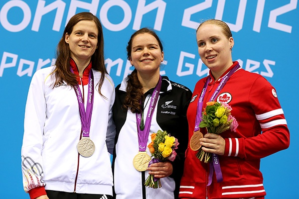 (L-R) Silver medallist Daniela Schulte of Germany, gold medallist Mary Fisher of New Zealand and bronze medallist Amber Thomas of Canada pose on the podium during the medal ceremony for the Women's 200m Individual Medley - SM11 final on day 10 of the London 2012 Paralympic Games at Aquatics Centre on September 8, 2012 in London, England. (Photo by Clive Rose/Getty Images)