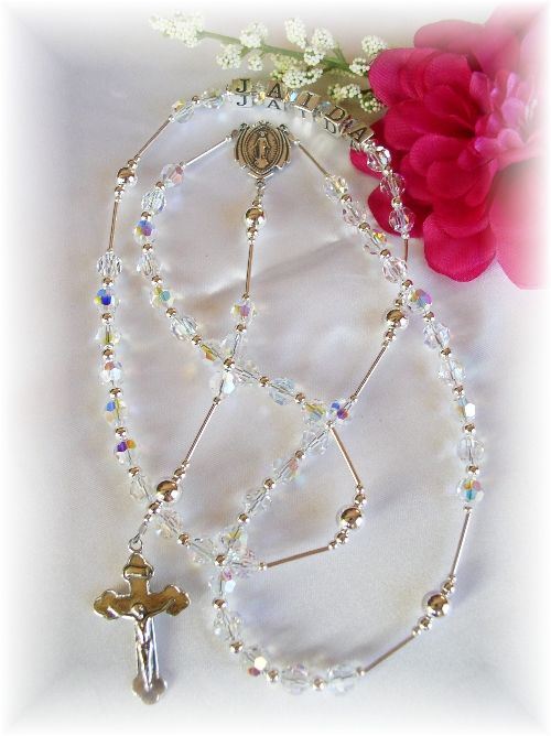 An heirloom keepsake rosary created in your choice of Swarovski birthstone colors crystals or alternating white pearl and crystals.  All .925 sterling silver accents and letter blocks.  Choose plain, or personalize it with name(s) or date(s)! A personalized rosary makes a wonderful gift for any occasion!   http://www.addictivejewelry.com/inc/sdetail/personalized_swarovski_crystal_rosary/263/8369