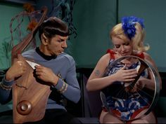 Spock on the Vulcan Harp accompanied by  space hippie on the bicycle wheel.