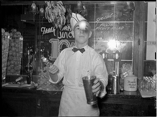 All sizes   Soda jerker flipping ice cream into malted milk shakes. Corpus Christi, Texas (LOC), via Flickr.