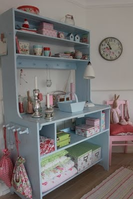 doing this for my craft/guest room.  Those darn guess take up too much space!  hutch or old dresser upcycled for storage - remove drawers and use shelves, pegs for baskets on sides all the way up, containers on top - craft, sewing, office or kids room