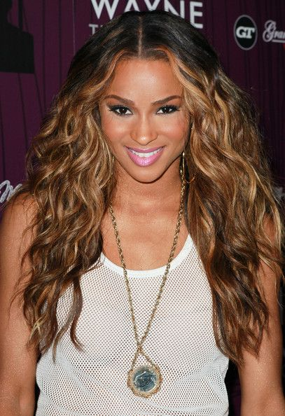 Ciara Long Wavy Cut  Ciara arrived with tresses flowing to Cash Money Records' Lil Wayne Album Release Party for 'Tha Carter IV'. To recreate the look, part hair down the center and use a large-barreled curing iron or enhance your own natural waves or curls. To keep hair shiny, we recommend an anti-frizz treatment like Josie Maran Argan Oil Hair Serum.                                                                                              #Ciara #Long_Wavy_Cut #Hair #LaurenJ