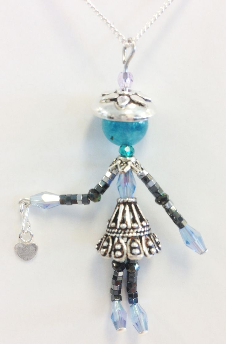 """HANDCRAFTED BY CJ STUDIO - GIGI GIGI IS 2"""" TALL Little Sidekicks are tiny, whimsical, collectable, jewelry people (Bead People). Each one is unique, and they have moveable parts. Little Sidekicks can be worn as a pendant on a chain or can have a clip added to use on a handbag or clipped onto a collar. Sidekicks make a great unique gift and can be made to order with personalized colors and charms."""