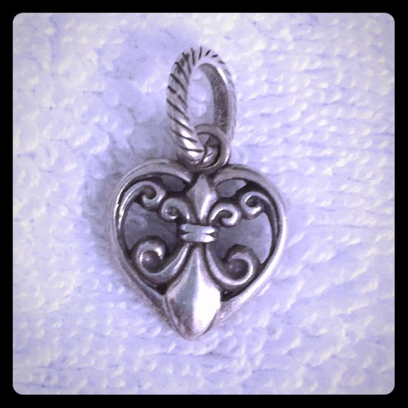 "Brighton Fleur De Lis Silver Heart Charm This beautiful silver-plated Fleur De Lis features an antique finish and gorgeous classic detailing. The surrounding heart is a perfect finishing touch for anyone who identifies with this classic heraldic crest. This charm was purchased in New Orleans where it is certainly a 'heartfelt' sentiment! Width:11/16""; Height:11/16"". This item is pre-owned in excellent condition! First come, first serve! Brighton Jewelry Bracelets"