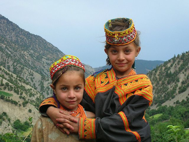 Kalash sisters - Pakistan.   Kalash people are a non-Muslim aboriginal minority living on the fringes of northern Pakistan. Their genetic makeup is so pure and distinct, that they are unlike other human races, thanks to their evolving DNA and rare alleles.