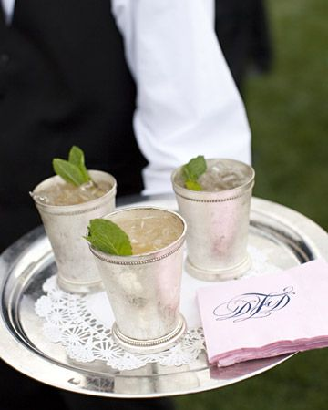 Mint juleps are served alongside napkins foil-stamped with the couple's monogram.
