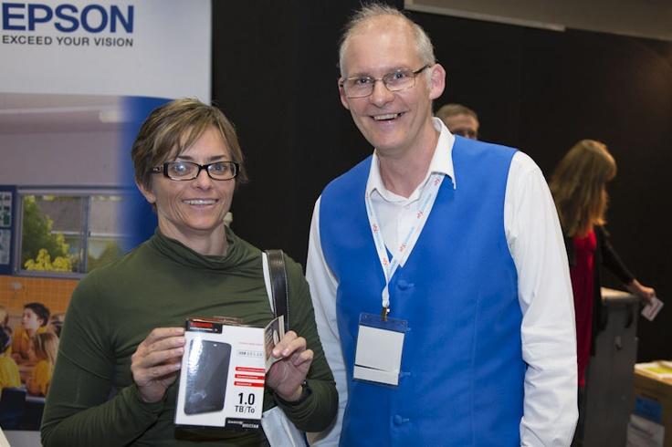 Toshiba Canvio 1TB hard drive prize winner with INTERFACE editor Greg Adams.