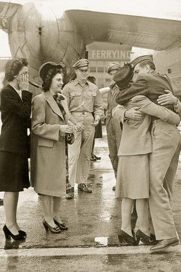 Louis Zamperini, reunited with his family in 1945 after spending 2 years in captivity. Here, he is hugging his mother as his sisters watch.