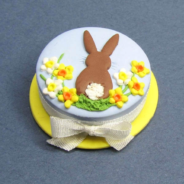 Dollhouse miniature cake suitable for Easter, Spring celebrations with bunny rabbit and daffodils. $10.00, via Etsy.