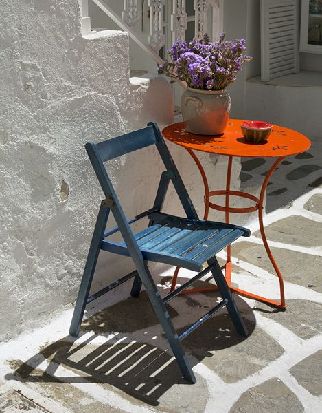 Chair and table on a Greek island: best place to read a book  or just watch people go by