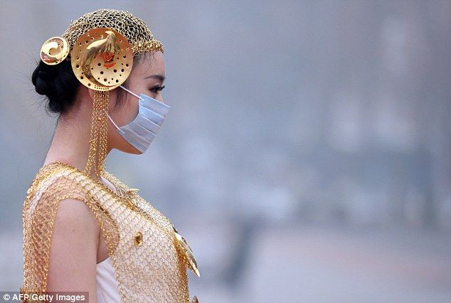 The models in masks: Shocking images show women forced to don medical garb for fashion event in smog-hit city of Nanjing The models at the jewellery showcase were forced to don masks Nanjing, in China's Jiangsu province, has endured a smog cloud for six days Air pollution due to rapid urbanisation and coal-fired power stations