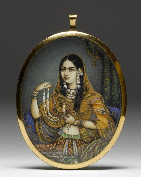 Miniature portrait pendant. Watercolor on ivory, gold, glass. 1830-1850, India. In this instance, an artist from Delhi has portrayed a courtesan dressed as a princess wearing elaborate Mughal gold and gem-set jewelry. Photo: The Walters Art Museum #jewelry #mughal