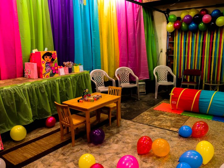 this too busy but good ideaparty city tablecloths covering the garage walls for colorful decoration - Party Decorating Ideas
