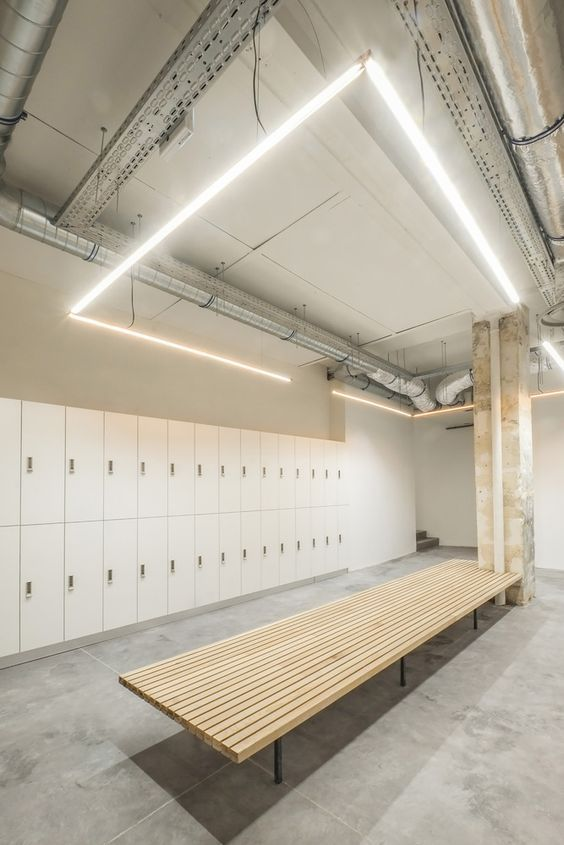 The cement floor and simple benches for locker rooms