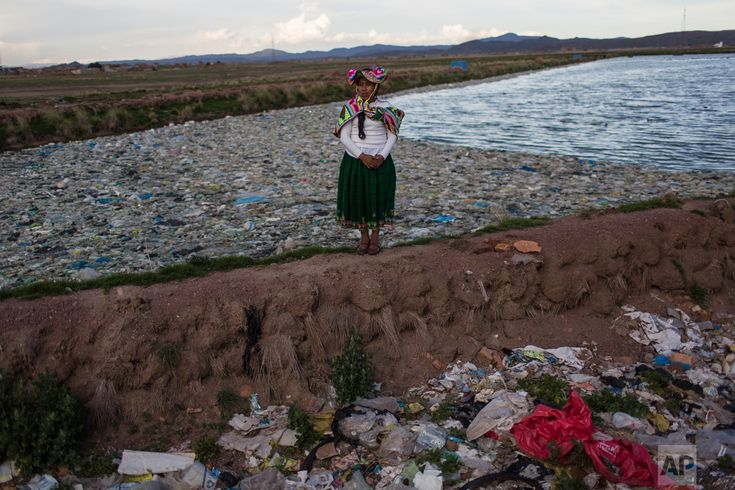 """In this Feb. 1, 2017 photo, environmental activist Maruja Inquilla poses for a photo next to a Municipal waste treatment plant with water that flows into Lake Titicaca, in Juliaca, in the Puno region of Peru. """"If the frogs could talk they would say, 'This is killing me,'"""" said Inquilla, who recently showed up at the Puno governor's house carrying plastic bags filled with hundreds of dead frogs in protest. (AP Photo/Rodrigo Abd)"""