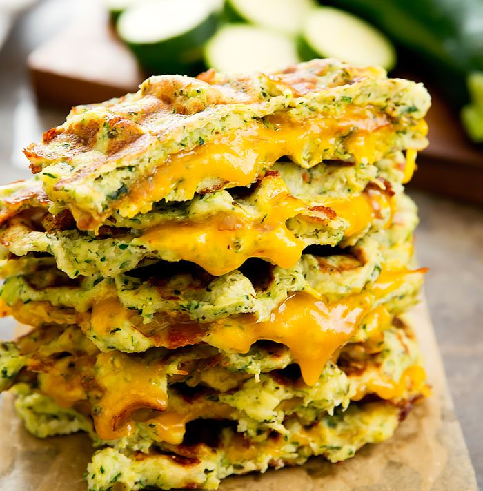 Zucchini waffle grilled cheese sandwiches are made with low-carb zucchini waffles and melted cheddar cheese. Both the waffles and sandwiches are cooked directly in your waffle iron for less clean-up.