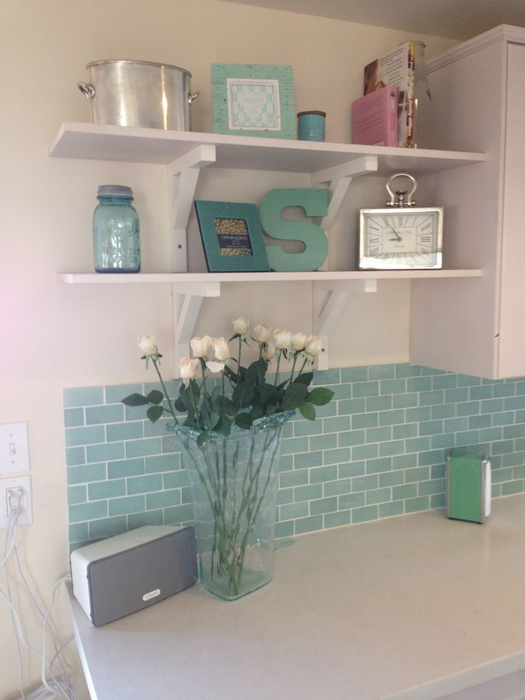 Inexpensive shelves in the kitchen. They open up the kitchen and are a great way to bring in more color in our beach house kitchen. http://www.venturabeachcottage.net/the-remodel-blog.html