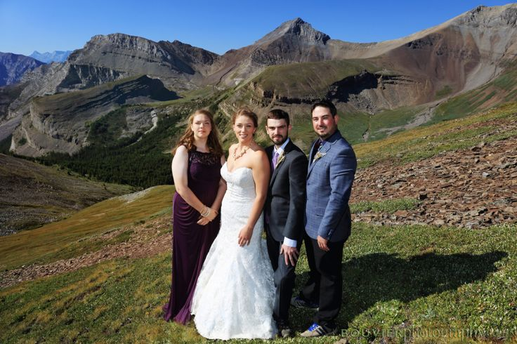 Wedding party on mountain side in Canmore Alberta. Summer heli-wedding. Summer heli-wedding.