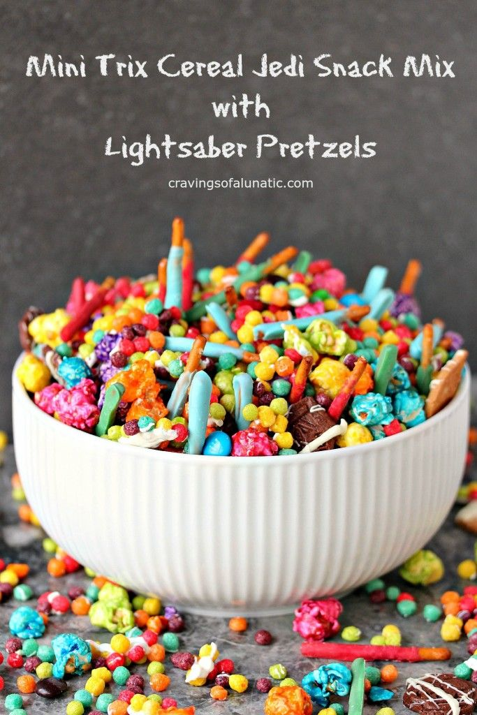 Mini Trix Cereal Jedi Snack Mix with Lightsaber Pretzels by cravingsofalunatic.com- This Jedi Snack Mix uses Mini Trix Cereal, Pretzels made into Lightsabers, coloured popcorn, tiny wafer cookies and M&M Candies. It's the perfect snack for the premiere of Star Wars: The Force Awakens! May the force be with you! (@CravingsLunatic)Lightsaber Pretzel Sticks from cravingsofalunatic.com- Whip up some lightsaber pretzel sticks, then toss them in my Mini Trix Cereal Jedi Snack Mix…