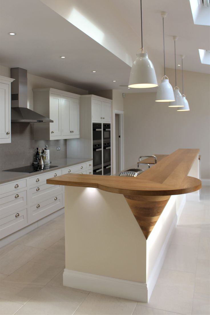 Long narrow island incorporating sink, workspace and a ...