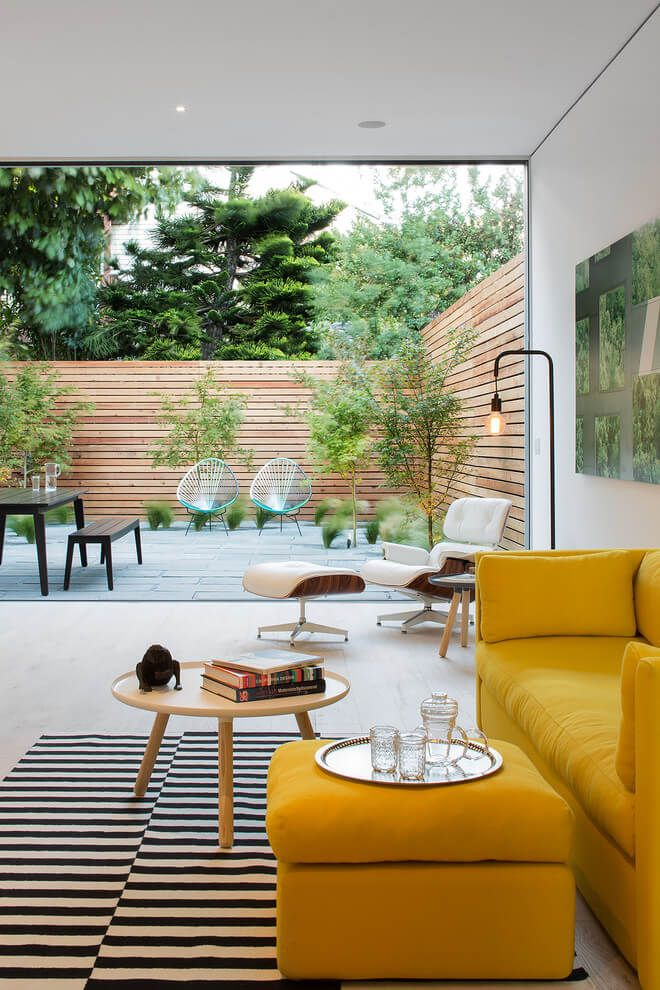 Mustard Yellow Couch Striped Rug Living Room Opens To Patio