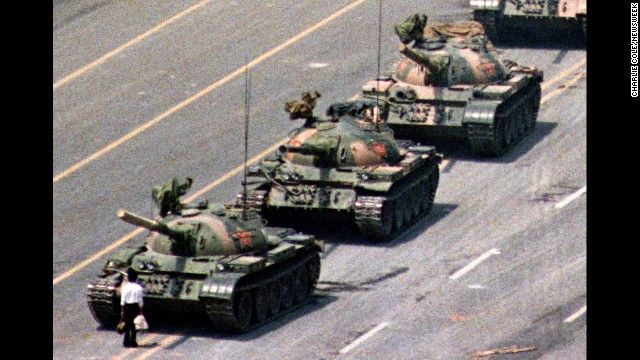 Following a crackdown that resulted in the deaths of hundreds of student demonstrators in Beijing, a lone Chinese protester steps in front of People's Liberation Army tanks in Tiananmen Squarein 1989.