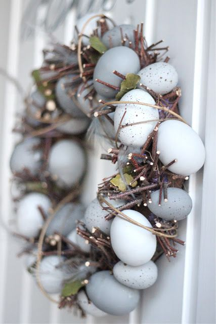 Hmmm. No tutorial. A great idea to build from, though. Wreath base, twigs, feathers, leaves, eggs, jute, hot glue.