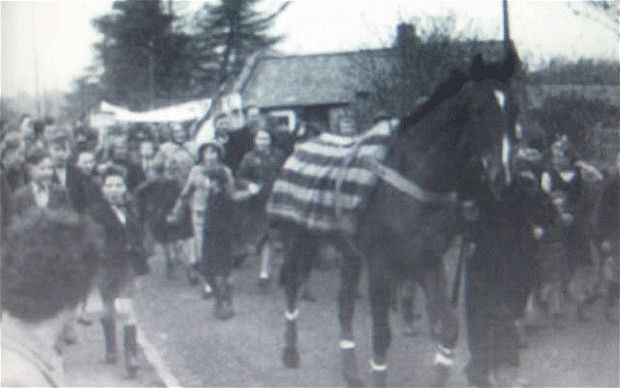 Glory day: Mr What is paraded through his hometown in Ireland after winning the 1958 Grand National