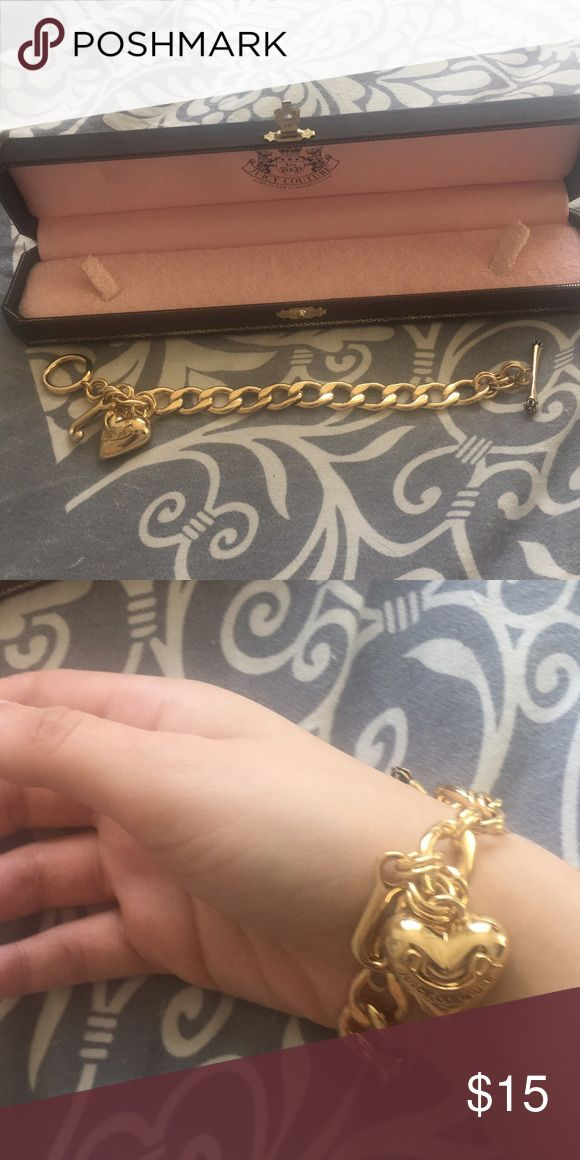 """Worn once Juicy's starter charm bracelet Really cute juicy bracelet! Worn maybe once and would make an amazing gift for someone! 7.5""""L Brass/14 Kt. gold plate/glass. Juicy Couture Jewelry Bracelets"""