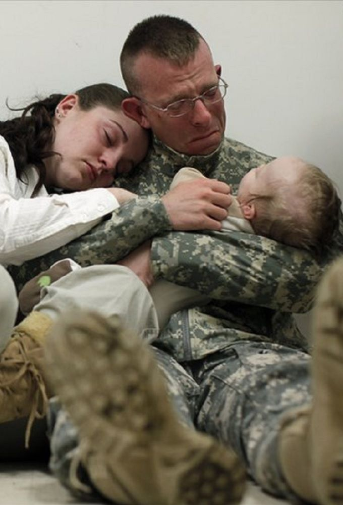 CREDIT: Damon Winter, Photographer. Army Sgt. Brian Keith during his last minutes with his family before deployment.