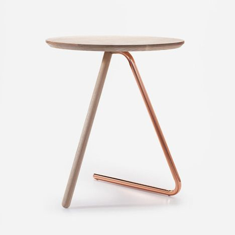 < 3 Side Table. Jonathan Sabine's less than three (aka heart emoticon) table does have less than three legs, two to be exact. The Fewer Than 3 side table does have three parts - a wood top, a wood dowel leg, and a bent tubular steel leg. The single steel leg bends so that it runs along the ground, making contact at two points. #heart