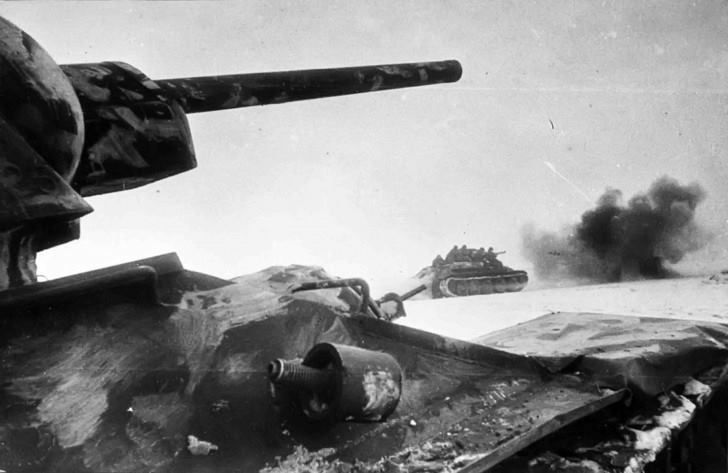 """A rare photograph of World War II in high definition. Soviet tanks T-34-76 on the offensive to the defensive positions of the enemy.The tank in the foreground is produced in the factory number 112 """"Krasnoye Sormovo""""."""