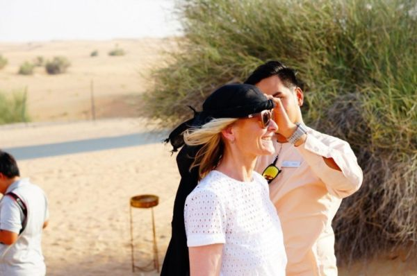 Getting the traditional headwear, which proved invaluable for keeping hair in place during our desert adventure.