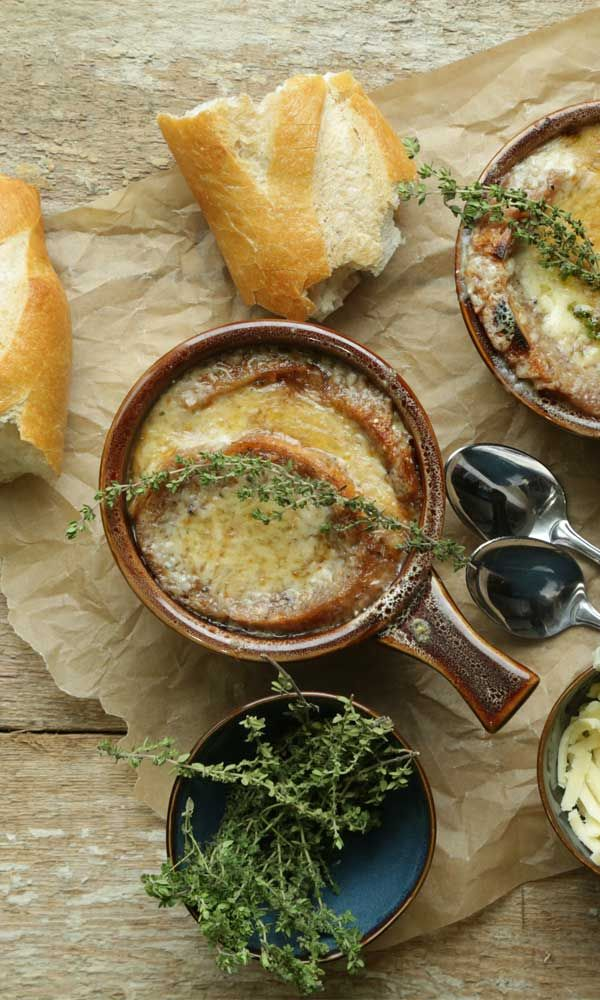 Try this delicious classic for Homemade French Onion Soup Recipe. Learn how to properly caramelize onions for this soup.