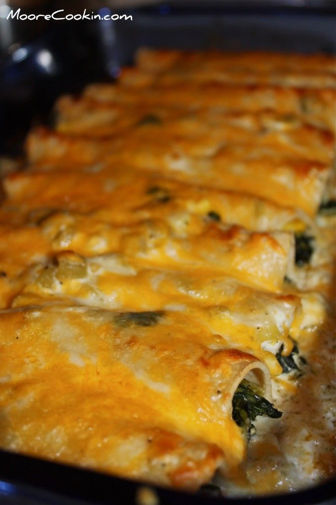 Creamy chicken and spinach enchiladas - My whole family loved these!  I used canned white beans instead of corn, and substituted flour tortillas, because that's what I had.  Easy weeknight meal.
