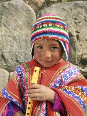 Portrait of a Peruvian Boy in a Knitted Hat, Playing the Flute, Near Cuzco, Peru, South America Lámina fotográfica por Gavin Hellier en AllPosters.es