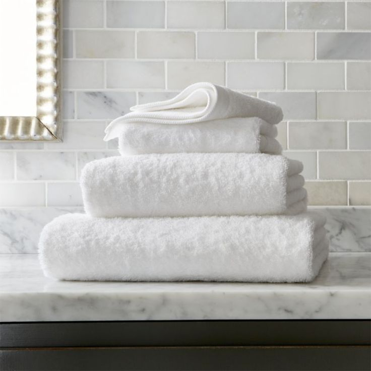 Shop Egyptian Cotton White Bath Towels.  Luxurious Egyptian combed cotton, prized for the extra long fibers that enhance both absorbency and durability, is woven in plush terry toweling in crisp white.