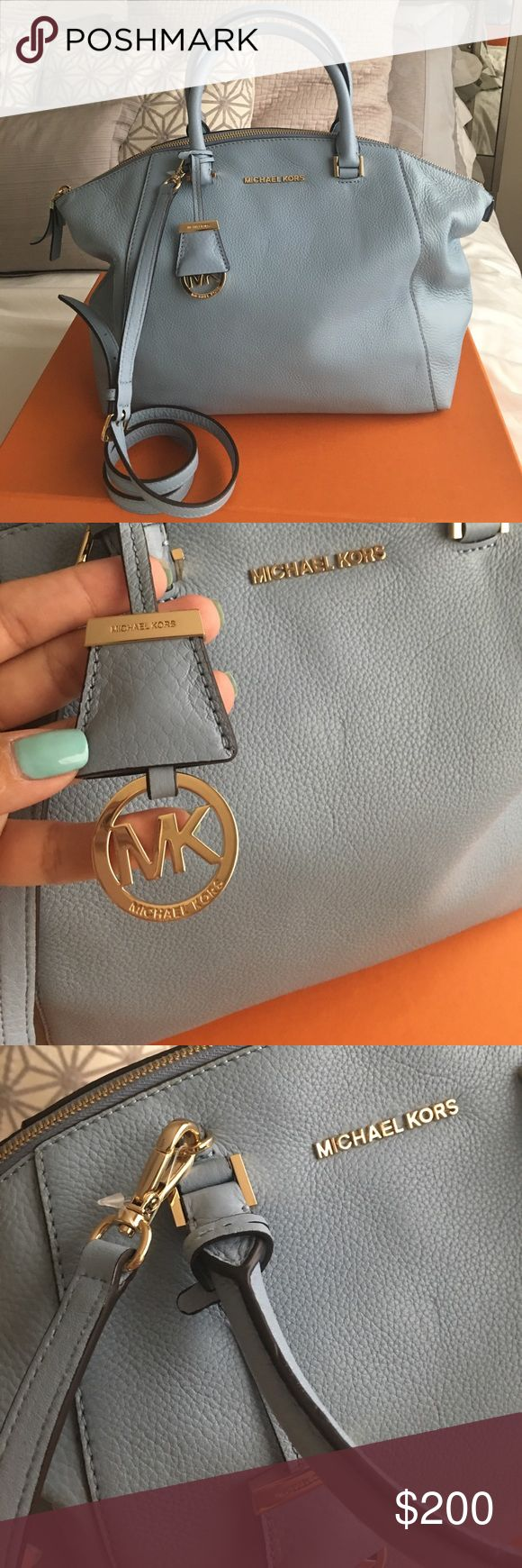 """Authentic Michael Kors Crossbody handbag Brand new, never used. No tags attached. Bought at Bloomingdales by my mother in law. Color is """"Denim"""". You have to forgive me, I don't know the name of the bag, I am not familiar with Michael Kors. You can use it as crossbody or just a tote. Very roomy. It has a pocket outside as well. Michael Kors Bags Crossbody Bags"""