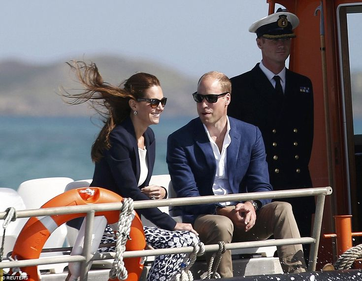 Kate's brown hair was blown about in the wind as the couple travelled to St Martins by boat
