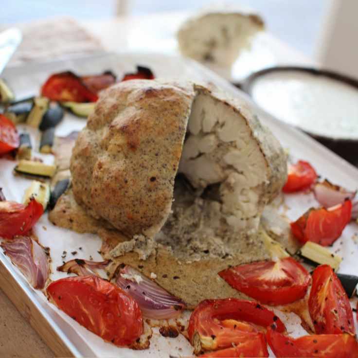 Roasted Whole Cauliflower with Tomato, Zucchini & Cashew Cream Tzatziki. Click Visit for the recipe on our blog.