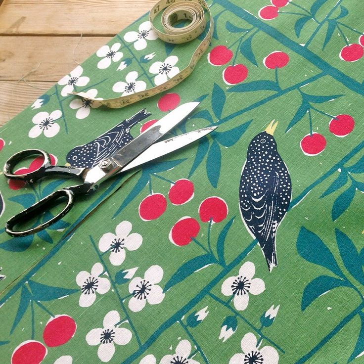 Cherry Orchard fabric by the metre featuring cherries and blackbirds by Marianne Westman from 1950. It's great for a vintage look and makes super curtains, Roman blinds or cushions in a dining space. Available from www.newhousetextiles.co.uk