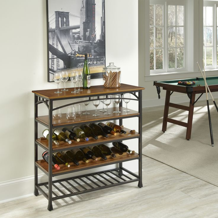 Reminiscent of the American Craftsman Era with understated style and simplicity, the Modern Craftsman Wine Storage Rack by Home Styles marries a distressed oak finish. This is constructed of oak veneer shelves with deep brown powder-coated metal.