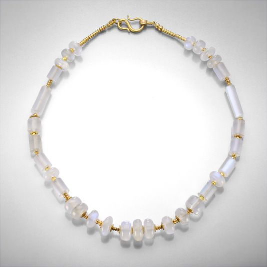 "A 22k yellow gold necklace with various blue and white moonstone and gold beads. Measures 17.25"" in total length."