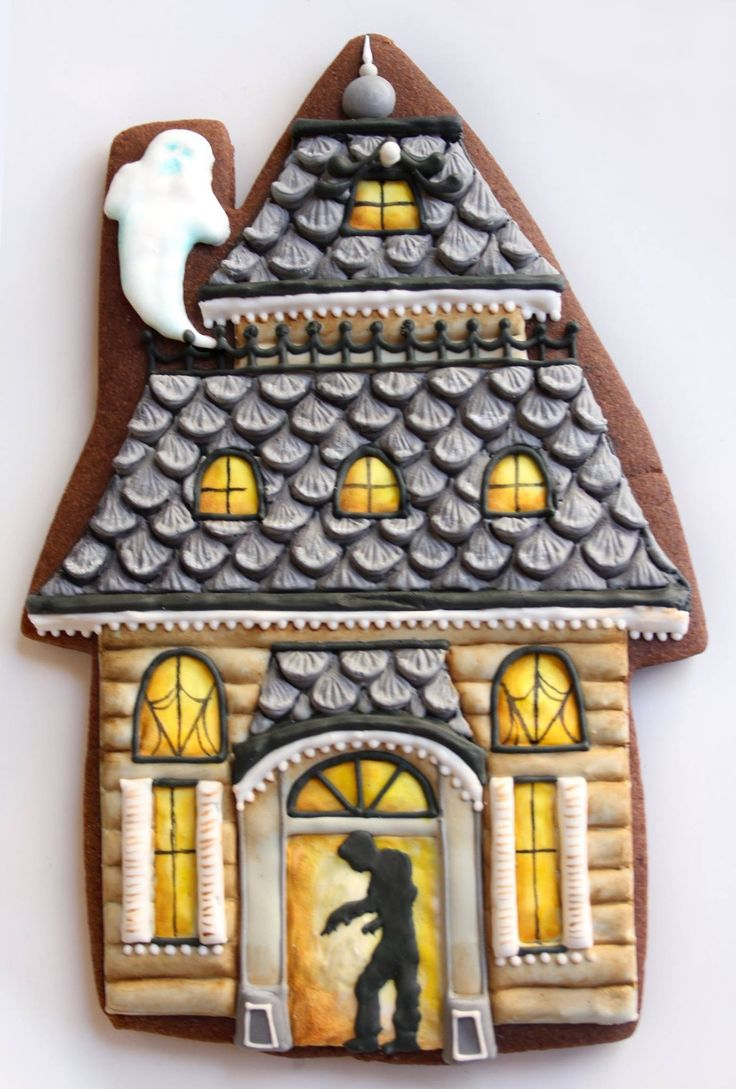 Crazy detailed haunted house iced cookie..