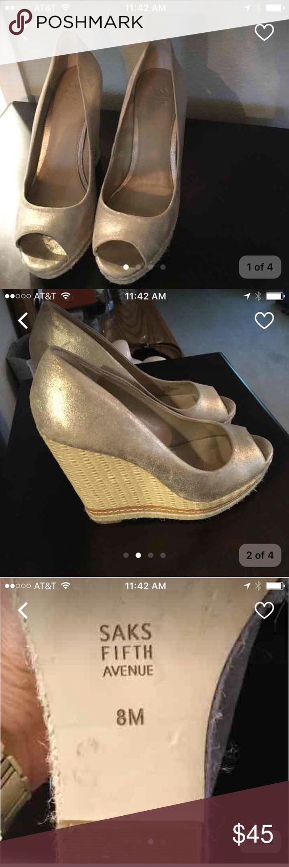 Saks Fifth Avenue Gold Wedge Shoes Sz 8 Light gold. Minor signs of use. Very pretty. Bought them on a whim. Not my regular size but had to have them. Used only a few times due to not fitting right. Original price was $160 Saks Fifth Avenue Shoes Wedges