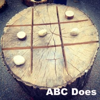 Got my husband to make me a noughts & crosses game for my outdoor area, using a tree stump & his chainsaw! We use natural objects to play the game i.e. Pebbles, shells, fir cones or tiny wooden cookies.