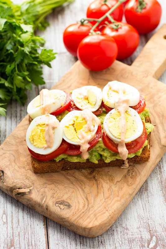 Avocado, Tomato, and Sliced Egg Toast: Creamy avocado layered with slices of ripe tomato and hard-boiled egg. Topped with a spicy chipotle crema.